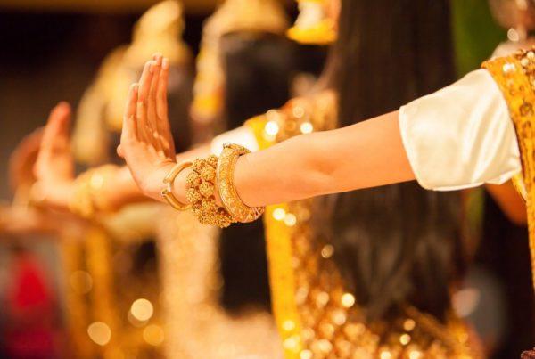 Beautiful hands of Apsara Khmer dance depicting the Ramayana epic. Phnom Phenh City, Cambodia. Glistening background.