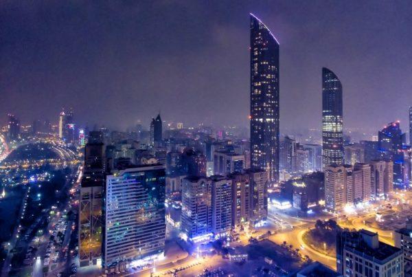 Night aerial view of Abu Dhabi Downtown Skyscrapers, UAE. Photo by Gagliardi Photography.