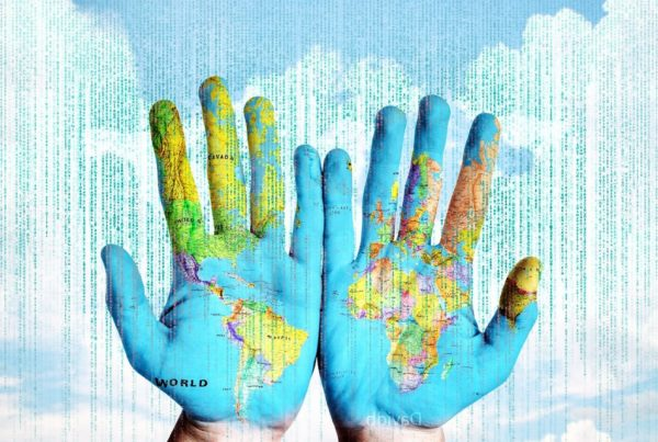 Hands, map, software, data. Image by David Bruyland from Pixabay.