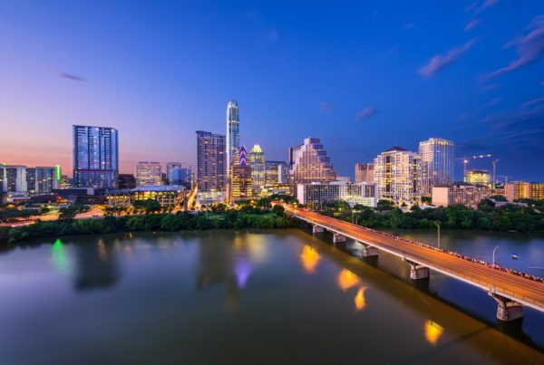 Austin, Texas, USA downtown skyline over the Colorado RIver. Photo by Sean Pavone Photo.