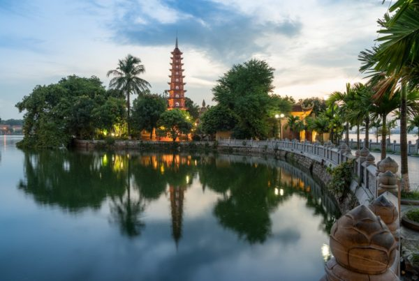 Tran Quoc pagoda during sunset time, the oldest temple in Hanoi, Vietnam. Hanoi cityscape. Photo by Vinhdai | Canva.