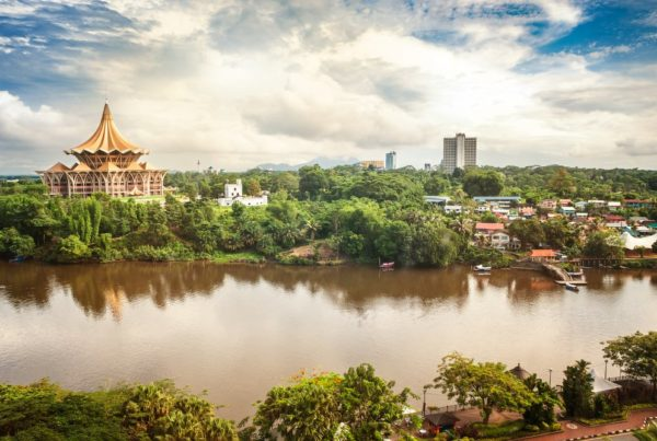 View over the Sarawak River to the north side of the city of Kuching with DUN complex (seat of the Parliament of the Malaysian state of Sarawak) and Fort Margherita, Borneo. Photo by NaLha.