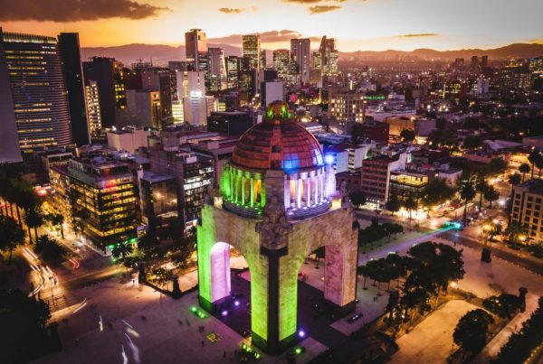 Mexico City, Mexico, aerial view of Plaza de la Republica and Mexico City skyline at dusk.