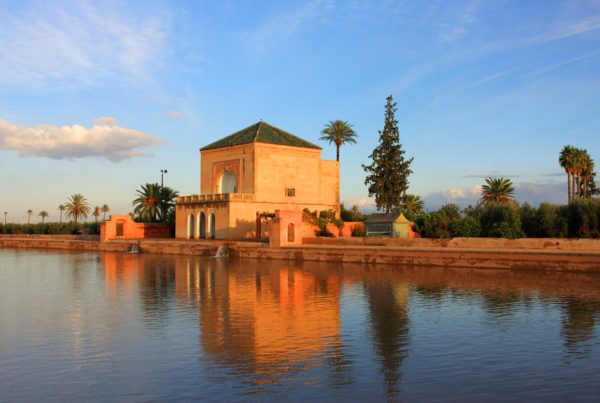 "The ""Menara Pavilion"" and gardens - one of Marrakesh's most popular tourist sites, reflected on its lake in late afternoon sunshine, Marrakesh, Morocco. Photo by JohnCopland."
