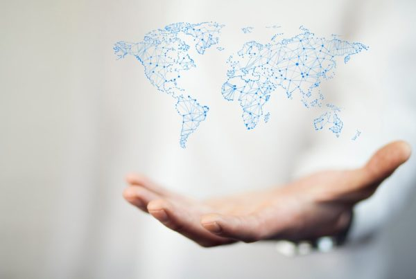 Image of businessman with world map in hand. Photo by Unknown | Canva.