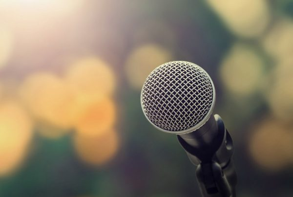 Image of microphone on blurred background. Photo by lovelyday12 | Canva.