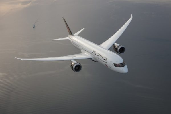 Image of Air Canada Dreamliner B787-9 flying over water. Photo courtesy of Air Canada.