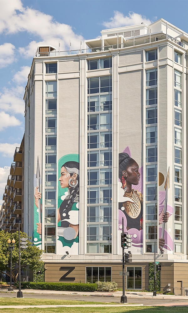 Hotel Zena in Washington, D.C. features more than 60 pieces of art celebrating female empowerment. Image shown at top of page is Figleaf bar and restaurant with portrait of Ruth Bader Ginsburg. Image above is of the female warrior mural on the exterior of the property. All images by Mike Schwartz Photography.