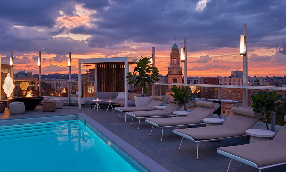 Hotel Zena will open Hedy's Rooftop, an upscale rooftop lounge, in the Spring of 2021. Image shows rooftop pool, artwork and chaises lounges. Photo by Mike Schwartz Photography.