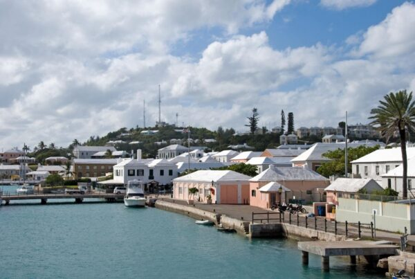 Bermuda's COVID-19 testing system has been enhanced to include a test triggered by travellers' return home dates. Image of Bermuda harbour by wwing for Canva.