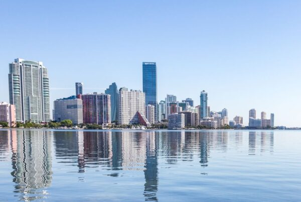 Treehouse Hotels will open its first U.S. property in Miami's Brickell area. Photo here shows Brickell office and condo towers reflecting in Biscayne Bay. Photo is by AlexCrab | Canva.