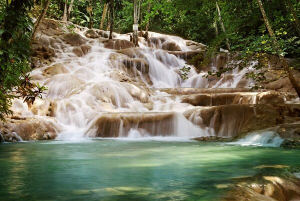 Sandals Resorts International is adding three properties to its Jamaica portfolio, including an iconic resort in Ocho Rios. Photo shows Dunn's River Falls in Ocho Rios. Photo by narvikk/Canva.