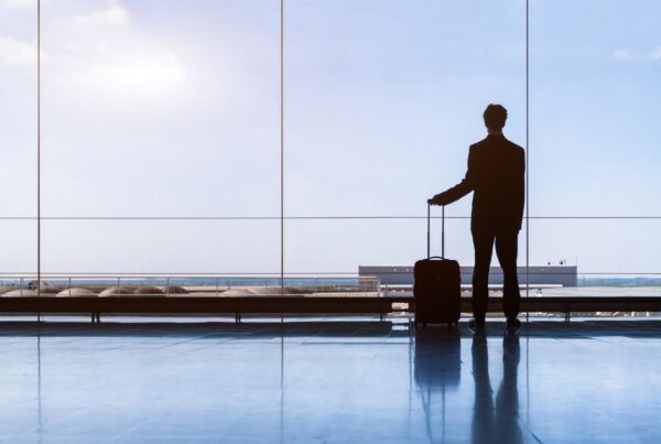 SITE Foundation has released a new white paper looking at the future of incentive travel as it recovers from the COVID-19 pandemic. Photo here shows a businessman in the waiting lounge of an airport. Photo is by NicoElNino from Getty Images Pro | Canva.