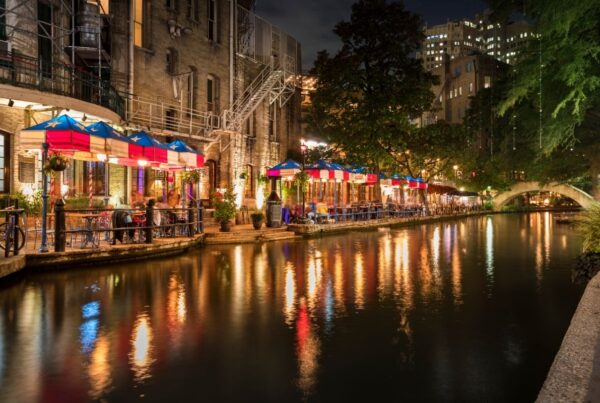 A new InterContinental hotel will open on San Antonio's River Walk in 2023. Image here shows restaurants at night along the River Walk canal. Photo by pgiam   Canva.