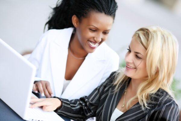EIC is now accepting applications for its IMEX America Hosted Buyer Program. Image here shows two women using laptop. Photo by skynesher from Getty Images Signature   Canva.