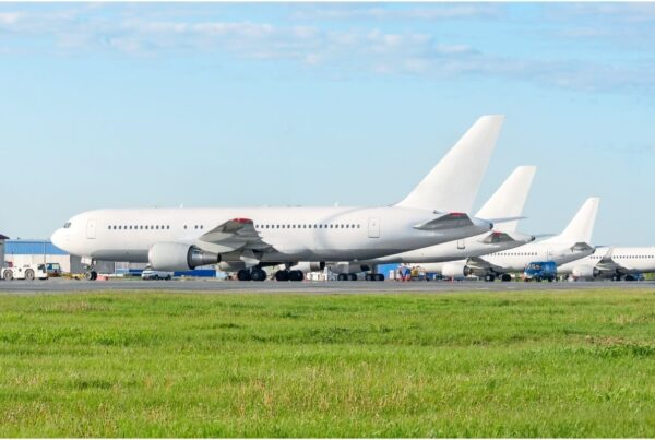 Global airline alliances are calling on the governments to align travel measures to facilitate recovery. Image here shows passenger planes parked at airport. Image is by appsky   Canva.
